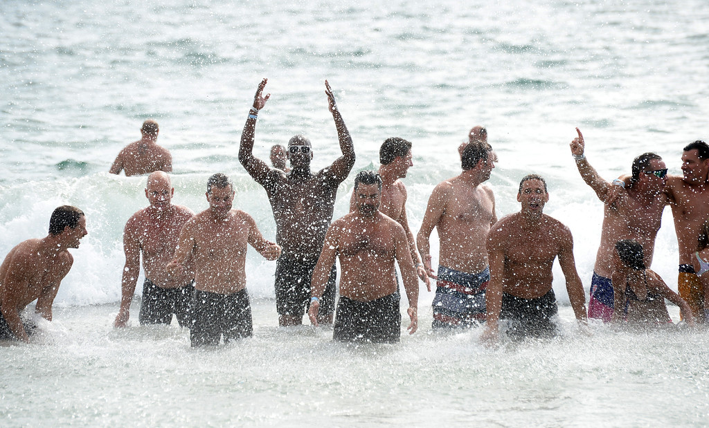 . Team Fletch celebrates with a dip in the ocean after they won the finals of the Charlie Saikley 6-Man Beach Volleyball tournament Saturday, August 05, 2017, Manhattan Beach, CA.  Team Fletch won the men\'s open competition and Horny Unicorny won the women\'s. (Photo by Steve McCrank, Daily Breeze/SCNG)