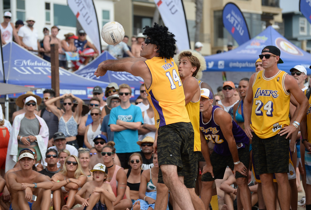 . Team Fletch makes a dig in the finals of the Charlie Saikley 6-Man Beach Volleyball tournament Saturday, August 05, 2017, Manhattan Beach, CA.  Team Fletch won the men\'s open competition and Horny Unicorny won the women\'s. (Photo by Steve McCrank, Daily Breeze/SCNG)