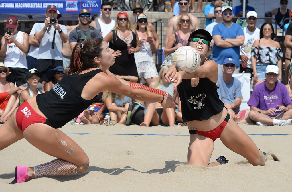 . Rock & Brews comes up with the save and avoids a collision in the finals of the Charlie Saikley 6-Man Beach Volleyball tournament Saturday, August 05, 2017, Manhattan Beach, CA.  Team Fletch won the men\'s open competition and Horny Unicorny won the women\'s. (Photo by Steve McCrank, Daily Breeze/SCNG)