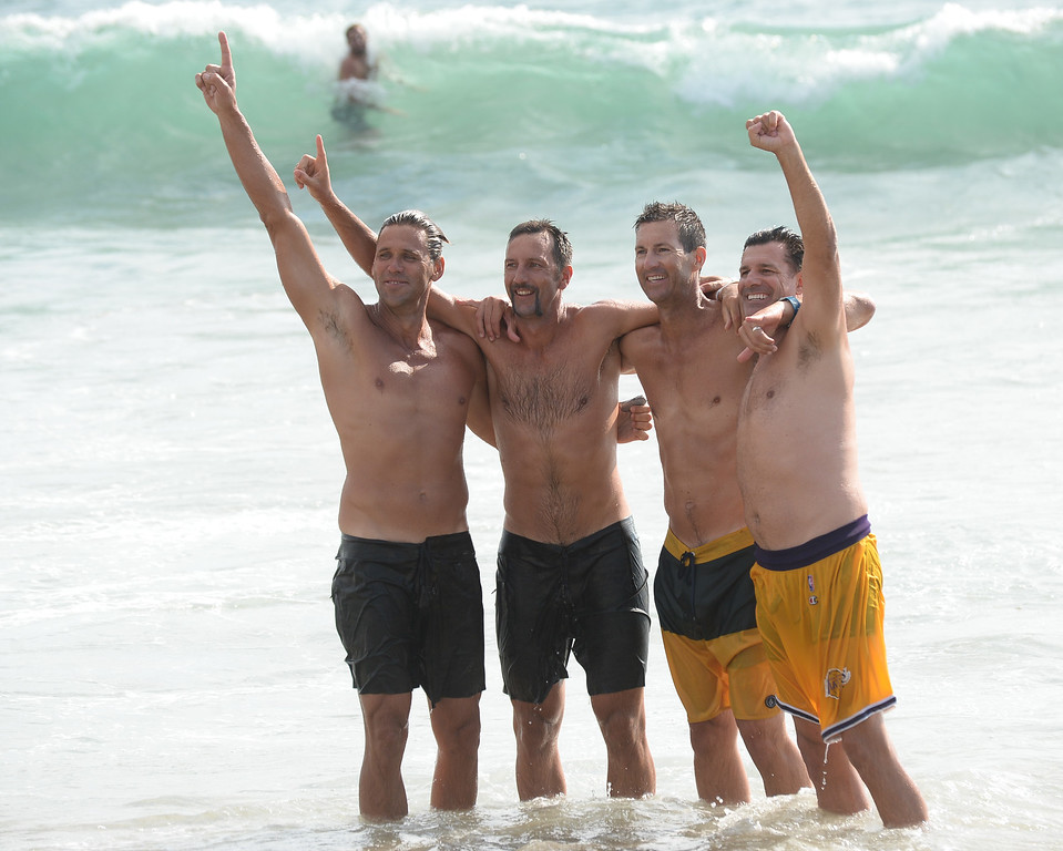 . Team Fletch, including Olympian Sean Rosenthal (second from left), celebrates with a dip in the ocean after they won the finals of the Charlie Saikley 6-Man Beach Volleyball tournament Saturday, August 05, 2017, Manhattan Beach, CA.  Team Fletch won the men\'s open competition and Horny Unicorny won the women\'s. (Photo by Steve McCrank, Daily Breeze/SCNG)