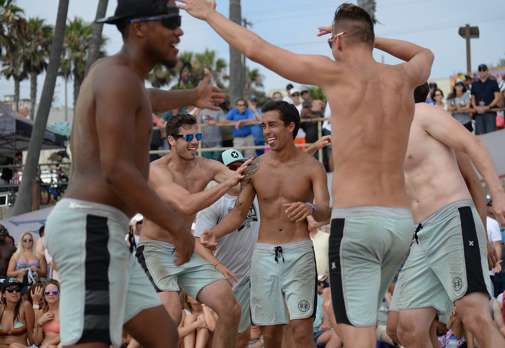 . Team Spyder celebrates a point in the finals of the Charlie Saikley 6-Man Beach Volleyball tournament Saturday, August 05, 2017, Manhattan Beach, CA.  Team Fletch won the men\'s open competition and Horny Unicorny won the women\'s. (Photo by Steve McCrank, Daily Breeze/SCNG)