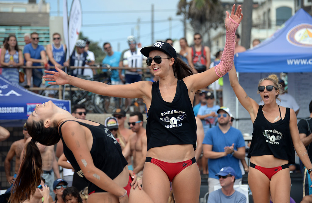 . Rock & Brews celebrates a point in the finals of the Charlie Saikley 6-Man Beach Volleyball tournament Saturday, August 05, 2017, Manhattan Beach, CA.  Team Fletch won the men\'s open competition and Horny Unicorny won the women\'s, with Rock & Brews second. (Photo by Steve McCrank, Daily Breeze/SCNG)
