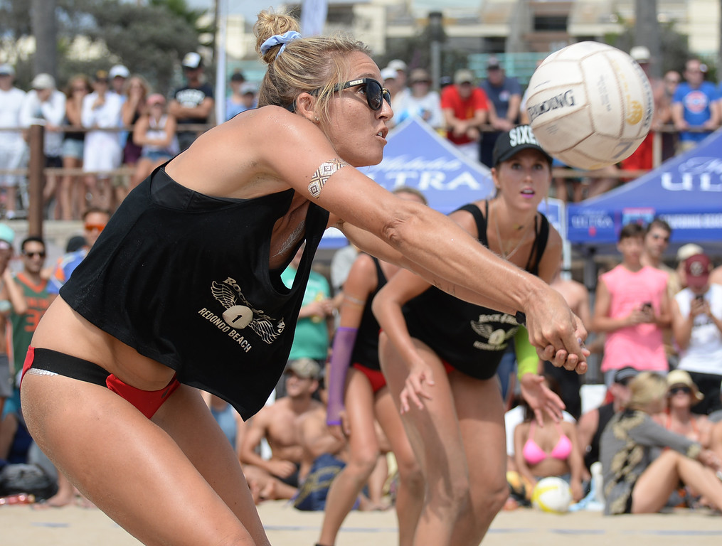 . Rock & Brews makes a bump-set in the finals of the Charlie Saikley 6-Man Beach Volleyball tournament Saturday, August 05, 2017, Manhattan Beach, CA.  Team Fletch won the men\'s open competition and Horny Unicorny won the women\'s. (Photo by Steve McCrank, Daily Breeze/SCNG)