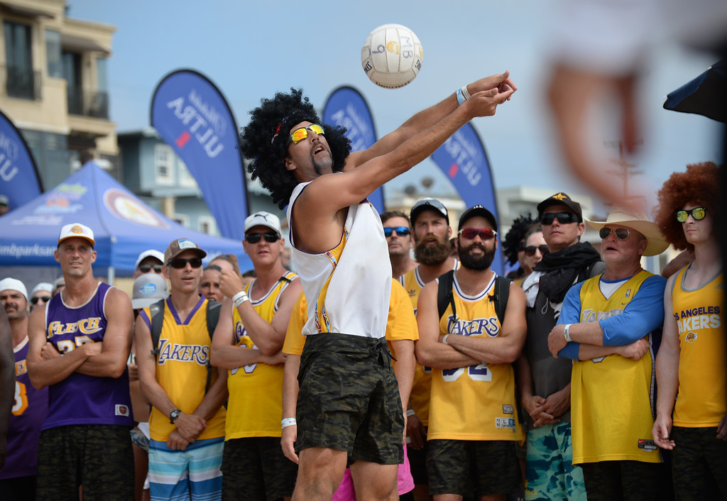 . Olympian Sean Rosenthal digs the ball from the back court as part of Team Fletch in the finals of the Charlie Saikley 6-Man Beach Volleyball tournament Saturday, August 05, 2017, Manhattan Beach, CA.  Team Fletch won the men\'s open competition and Horny Unicorny won the women\'s. (Photo by Steve McCrank, Daily Breeze/SCNG)