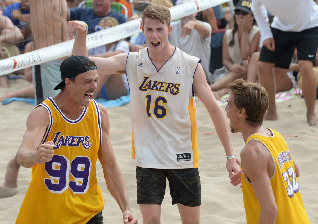 . Team Fletch celebrates a point in the finals of the Charlie Saikley 6-Man Beach Volleyball tournament Saturday, August 05, 2017, Manhattan Beach, CA.  Team Fletch won the men\'s open competition and Horny Unicorny won the women\'s. (Photo by Steve McCrank, Daily Breeze/SCNG)