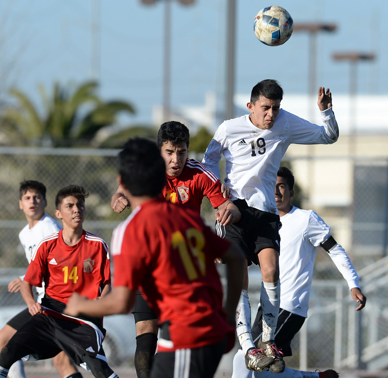 . Lawndale\'s Anthony Canseco (19) gets to the ball above Hawthorne in an Ocean League soccer game Wednesday, January 25, 2017, Lawndale, CA.   Photo by Steve McCrank, Daily Breeze/SCNG