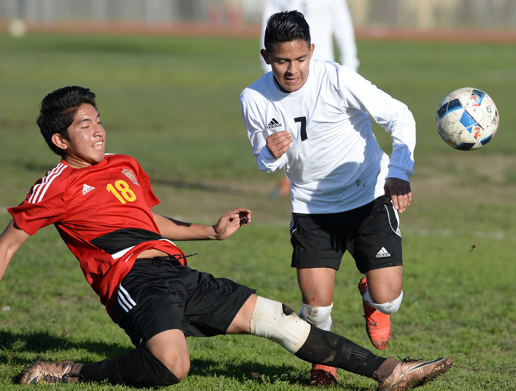 . Lawndale\'s Osvaldo Garcia (7) tries to get the ball through Hawthorne\'s Cristian Martinez (18) in an Ocean League soccer game Wednesday, January 25, 2017, Lawndale, CA.   Photo by Steve McCrank, Daily Breeze/SCNG