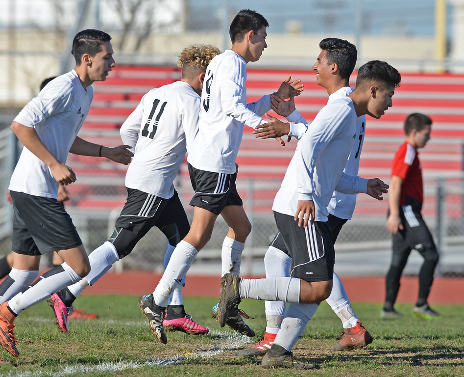 . Lawndale\'s Anthony Canseco (19), center, is mobbed by teammates as they celebrate Canseco\'s goal on Hawthorne in an Ocean League soccer game Wednesday, January 25, 2017, Lawndale, CA.   Photo by Steve McCrank, Daily Breeze/SCNG