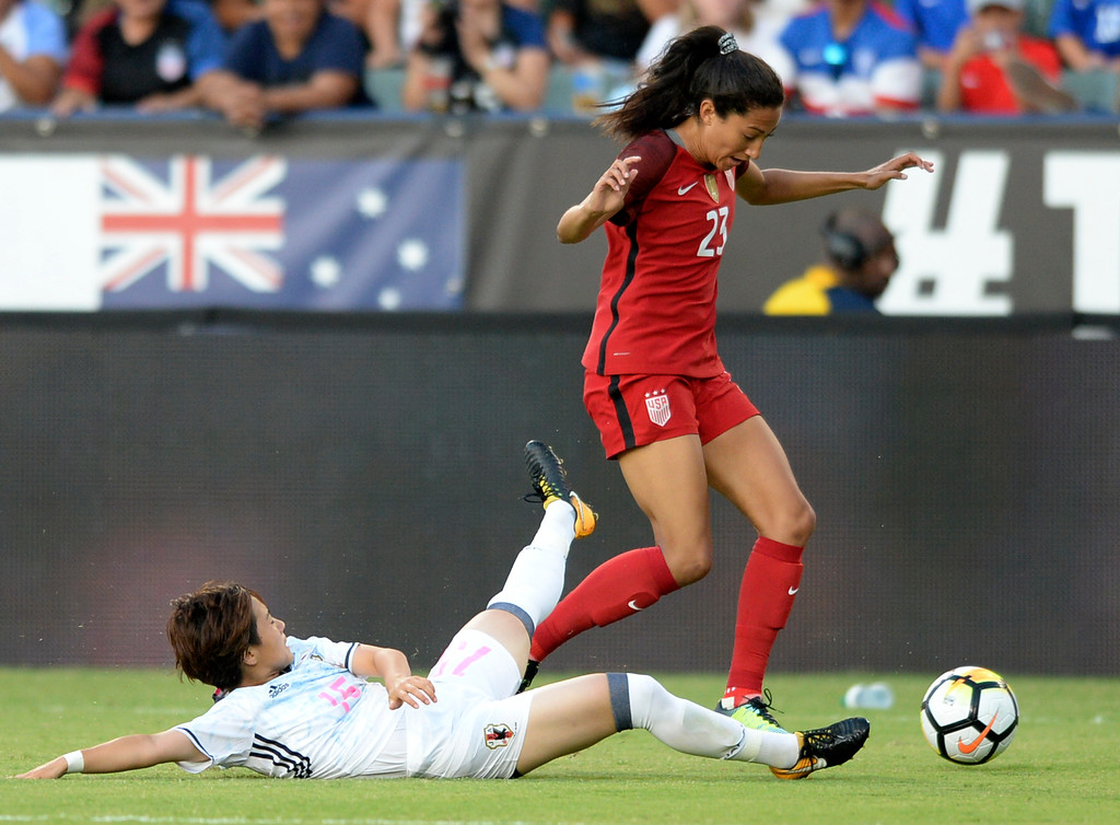 . USA\'s Christen Press (23) gets past Japan\'s Yuka Momiki (15) in the final womens soccer game of the Tournament of Nations at the StubHub Center Thursday, August 03, 2017, Carson, CA.  USA held a 1-0 lead at halftime. (Photo by Steve McCrank, Daily Breeze/SCNG)