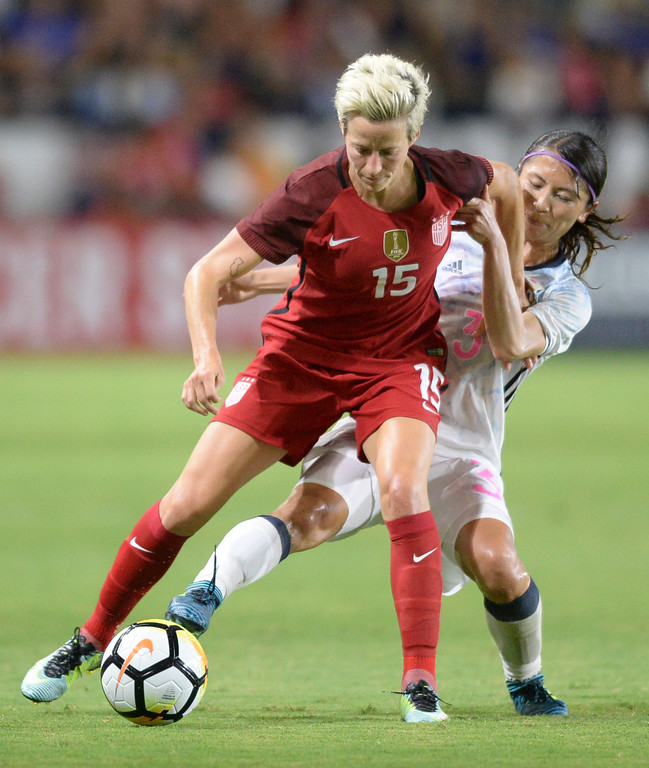 . USA\'s Megan Rapinoe (15) fends-off Japan\'s Aya Sameshima (3) in the final women\'s soccer game of the Tournament of Nations at the StubHub Center Thursday, August 03, 2017, Carson, CA.  USA won 3-0, but Australia took the tournament title. (Photo by Steve McCrank, Daily Breeze/SCNG)
