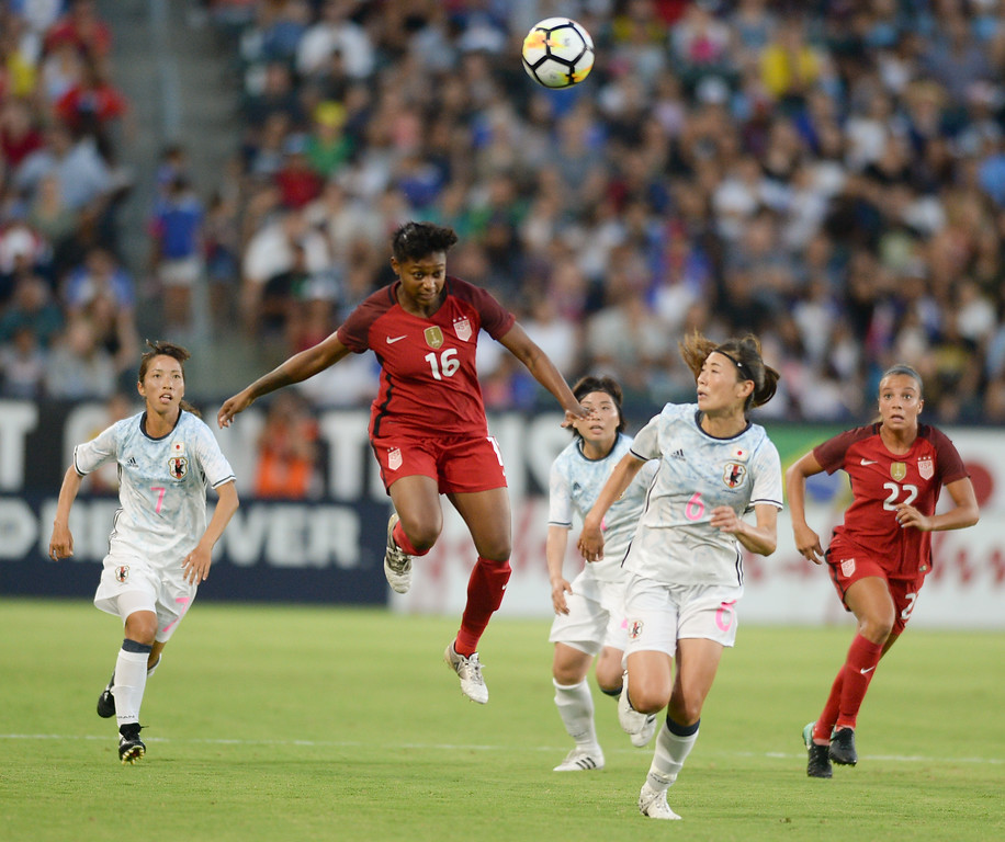 . USA\'s Taylor Smith (16) gets above Japan\'s Rumi Utsugi (6) as she moves the ball from midfield in the final womens soccer game of the Tournament of Nations at the StubHub Center Thursday, August 03, 2017, Carson, CA.  USA held a 1-0 lead at halftime. (Photo by Steve McCrank, Daily Breeze/SCNG)