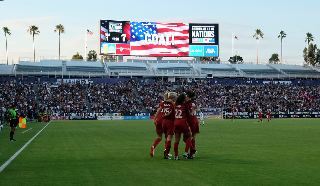 . USA\'s Megan Rapinoe is hugged by teammates as the scoreboard annoucnes her goal on Japan in the final women\'s soccer game of the Tournament of Nations at the StubHub Center Thursday, August 03, 2017, Carson, CA.  USA held a 1-0 lead at halftime. (Photo by Steve McCrank, Daily Breeze/SCNG)