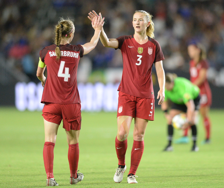 . USA\'s Becky Sauerbrunn (4) and Samantha Mewis (3) high five after beating Japan in the final women\'s soccer game of the Tournament of Nations at the StubHub Center Thursday, August 03, 2017, Carson, CA.  USA won 3-0, but Australia took the tournament title. (Photo by Steve McCrank, Daily Breeze/SCNG)