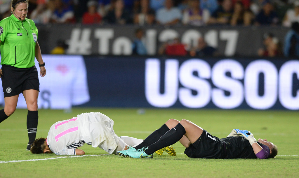 . USA\'s keeper Alyssa Naeher (1) deflects a shot from Japan\'s Mina Tanaka (11), shaking herself up on the play, in the final women\'s soccer game of the Tournament of Nations at the StubHub Center Thursday, August 03, 2017, Carson, CA.  USA won 3-0, but Australia took the tournament title. (Photo by Steve McCrank, Daily Breeze/SCNG)