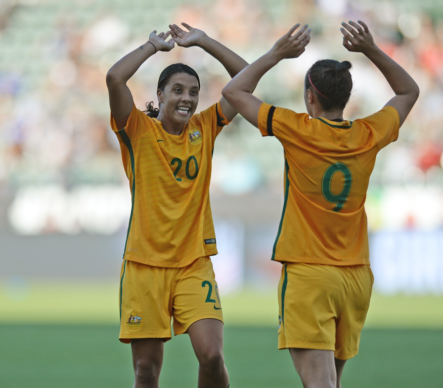 . Australia\'s Sam Kerr (20) and Caitlin Foord (9) celebrate another goal by Foord on Brazil in the final soccer game of the Tournament of Nations at the StubHub Center Thursday, August 03, 2017, Carson, CA.  Australia won 6-1 and the win gives them the tournament title. (Photo by Steve McCrank, Daily Breeze/SCNG)
