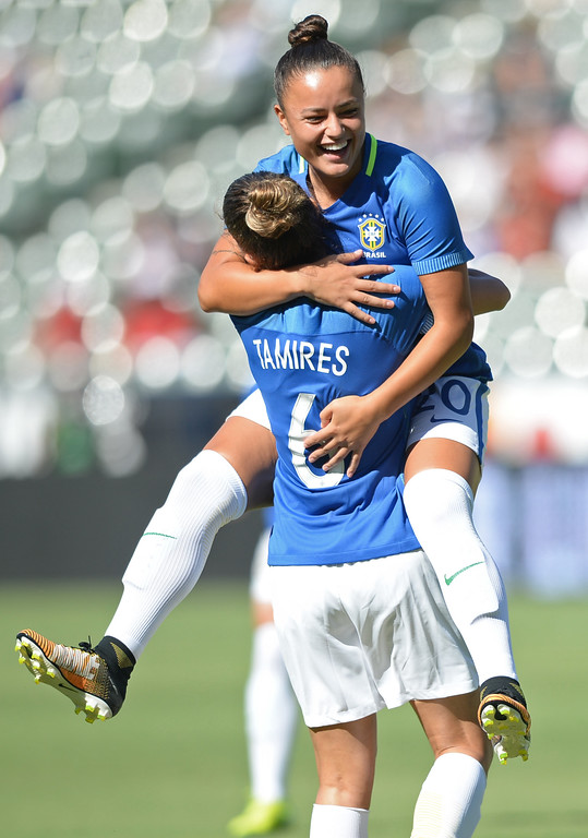 . Brazil\'s Camila (20) is hugged by teammate Tamires (6) after scoring an early goal on Australia in the final soccer game of the Tournament of Nations at the StubHub Center Thursday, August 03, 2017, Carson, CA.  Australia won 6-1 and the win gives them the tournament title. (Photo by Steve McCrank, Daily Breeze/SCNG)