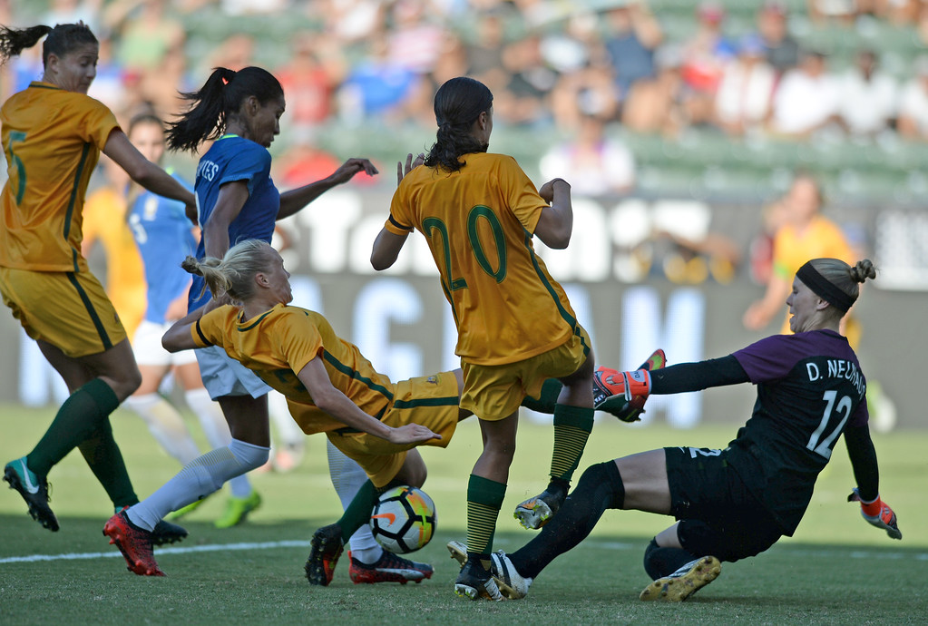 . Australia\'s Tameka Butt (13) attempts a shot as Brazil\'s keeper Dani Neuhaus (12) slides in in the final soccer game of the Tournament of Nations at the StubHub Center Thursday, August 03, 2017, Carson, CA.  Australia won 6-1 and the win gives them the tournament title. (Photo by Steve McCrank, Daily Breeze/SCNG)