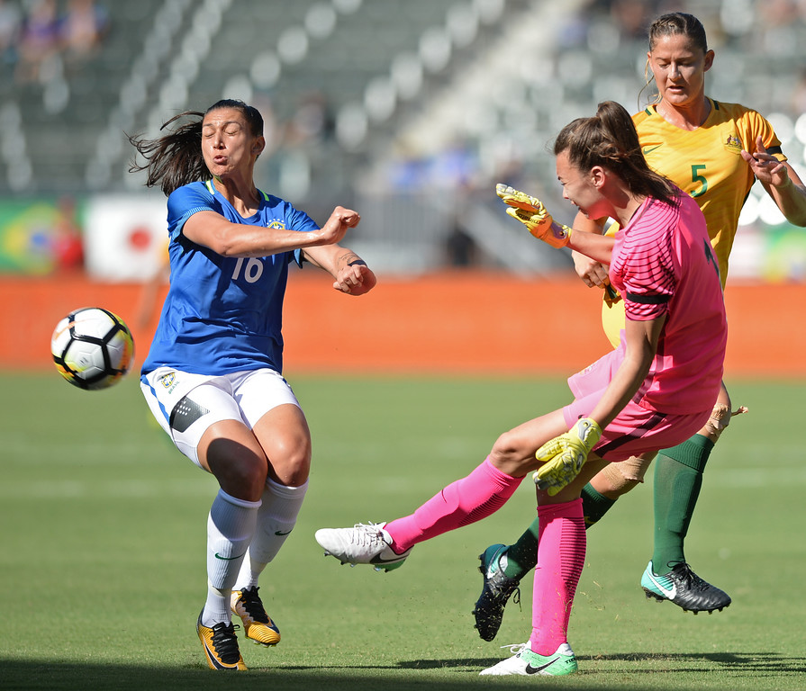 . Australia\'s keeper Mackenzie Arnold (1) boots the ball clear from Brazil\'s Bia Zaneratto (16) in the final soccer game of the Tournament of Nations at the StubHub Center Thursday, August 03, 2017, Carson, CA.  Australia won 6-1 and the win gives them the tournament title. (Photo by Steve McCrank, Daily Breeze/SCNG)
