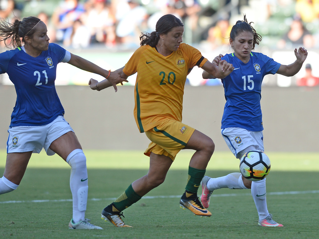 . Australia\'s Sam Kerr (20) breaks through to score a goal past Brazil\'s Monica (21) and Leticia (15) in the final soccer game of the Tournament of Nations at the StubHub Center Thursday, August 03, 2017, Carson, CA.  Australia won 6-1 and the win gives them the tournament title. (Photo by Steve McCrank, Daily Breeze/SCNG)