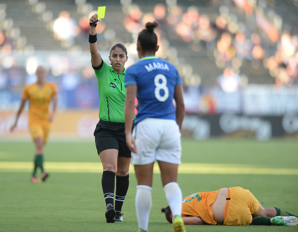 . Australia\'s Caitlin Foord (9) lies on the ground as Brazil\'s Maria (8) draws a yellow card for aggressive play in the final soccer game of the Tournament of Nations at the StubHub Center Thursday, August 03, 2017, Carson, CA.  Australia won 6-1 and the win gives them the tournament title. (Photo by Steve McCrank, Daily Breeze/SCNG)