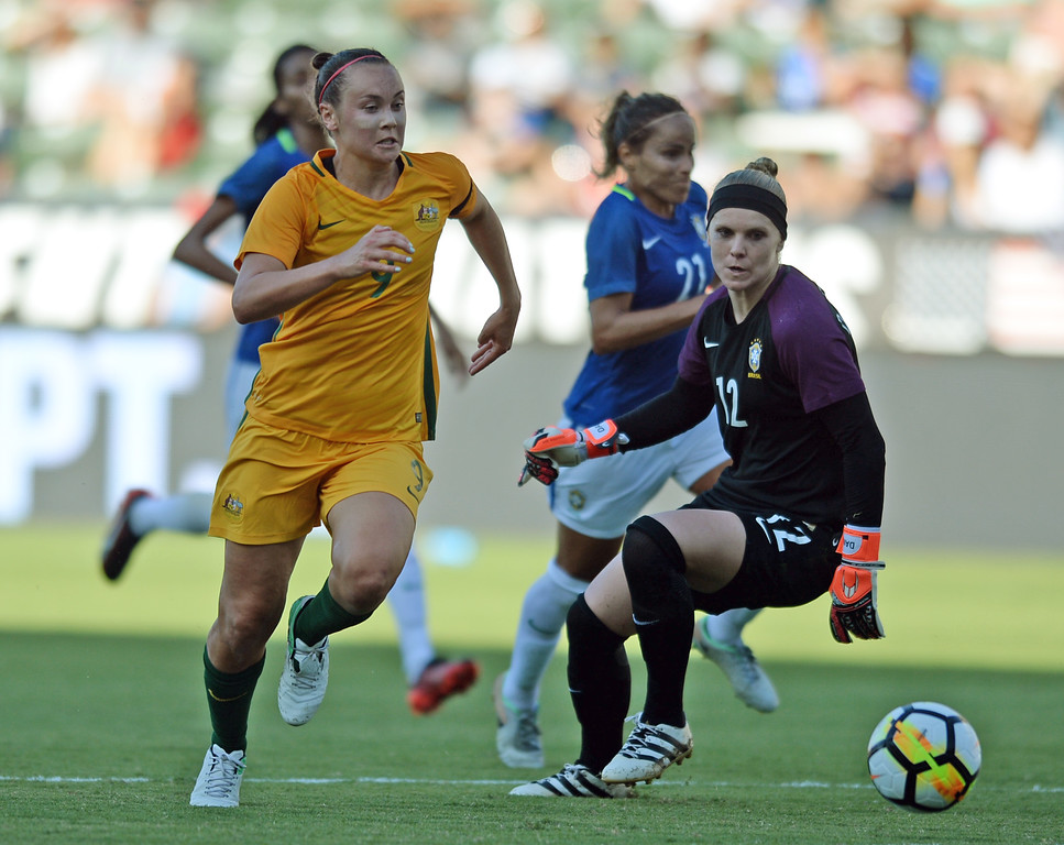 . Australia\'s Caitlin Foord (9) gets the ball through Brazil\'s keeper Dani Neuhaus to score a goal in the final soccer game of the Tournament of Nations at the StubHub Center Thursday, August 03, 2017, Carson, CA.  Australia won 6-1 and the win gives them the tournament title. (Photo by Steve McCrank, Daily Breeze/SCNG)