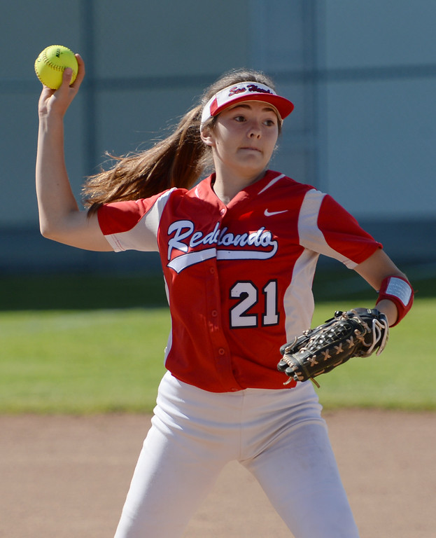 . Redondo pitcher Laura Chafe (21) makes an out to first on Peninsula  in a Bay League softball game Wednesday, April 19, 2017, Rolling Hills Estates. (Photo by Steve McCrank, Daily Breeze/SCNG)