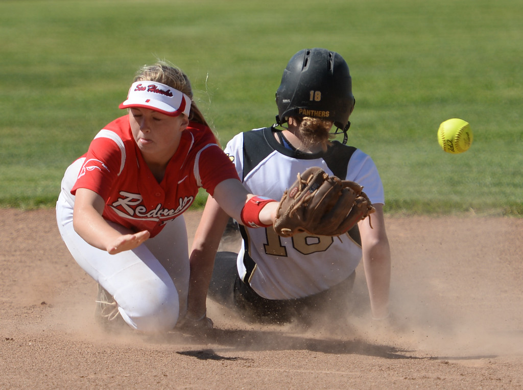 . Peninsula\'s Nicole Hay (18) slides into second as the throw gets past Redondo\'s Dara English (10) in a Bay League softball game Wednesday, April 19, 2017, Rolling Hills Estates. (Photo by Steve McCrank, Daily Breeze/SCNG)