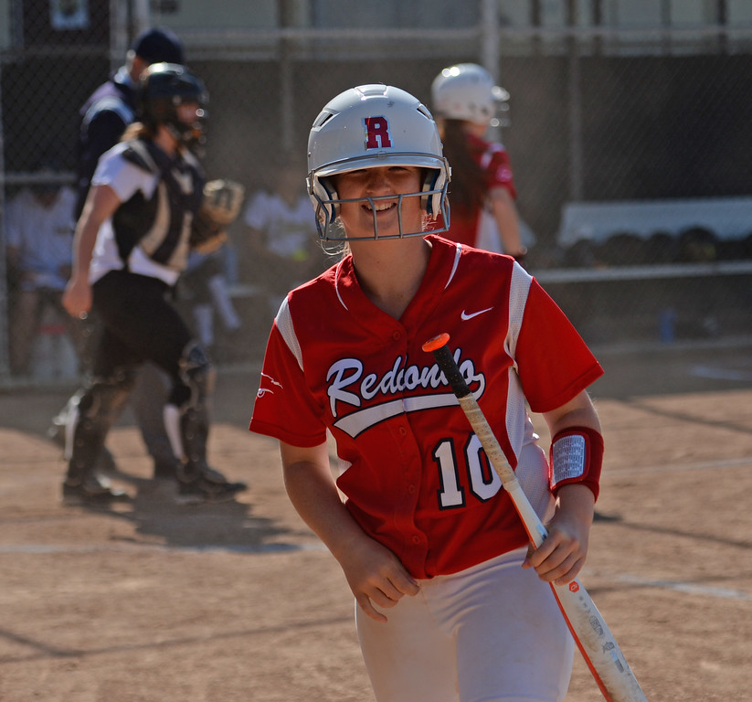 . Redondo\'s Dara English (10) comes back to the dug out all smiles after scoring on Peninsula in a Bay League softball game Wednesday, April 19, 2017, Rolling Hills Estates. (Photo by Steve McCrank, Daily Breeze/SCNG)