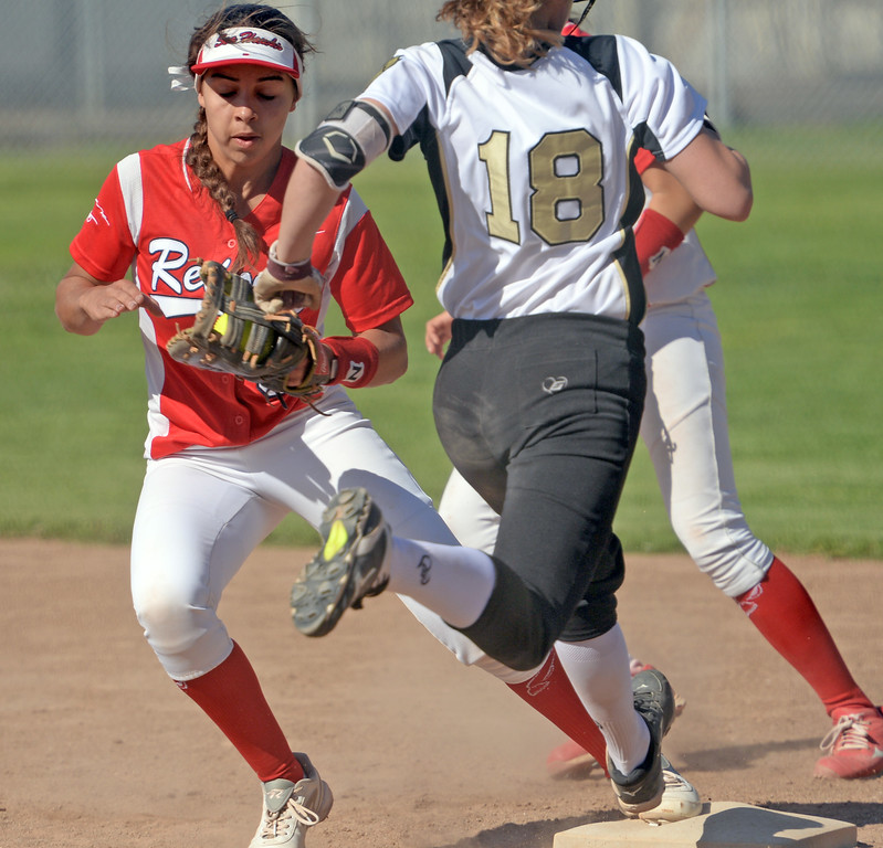 . Redondo\'s Victoria Hamilton (3) makes the out at first on Peninsula\'s Nicole Hay (18) in a Bay League softball game Wednesday, April 19, 2017, Rolling Hills Estates. (Photo by Steve McCrank, Daily Breeze/SCNG)
