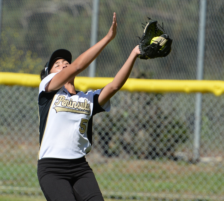 . Peninsula\'s Jasmine Nguyen (5) makes a catch on a foul Redondo fly ball in a Bay League softball game Wednesday, April 19, 2017, Rolling Hills Estates. (Photo by Steve McCrank, Daily Breeze/SCNG)