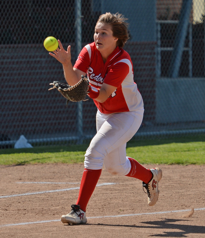 . Redondo\'s Kylie Fraser (17) makes a play on a Peninsula hit near third in a Bay League softball game Wednesday, April 19, 2017, Rolling Hills Estates. (Photo by Steve McCrank, Daily Breeze/SCNG)