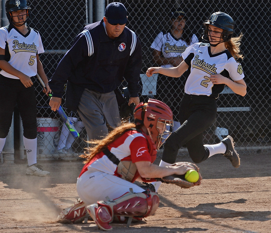 . Peninsula\'s Claire Bogosian (2) gets to home safely past the throw to Redondo\'s Megan Whipp (27) in a Bay League softball game Wednesday, April 19, 2017, Rolling Hills Estates. (Photo by Steve McCrank, Daily Breeze/SCNG)