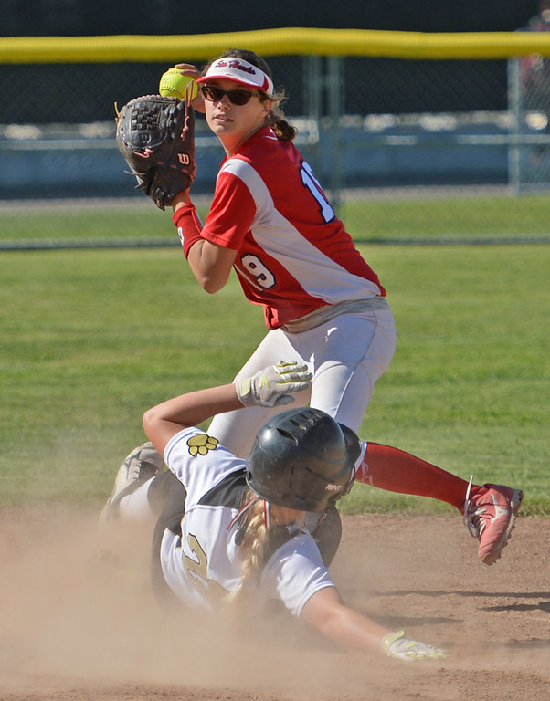 . Redondo\'s MacKenzie Sumrall (19) tries to turn a double play after forcing out Peninsula\'s Hannah Lyons (20) at second in a Bay League softball game Wednesday, April 19, 2017, Rolling Hills Estates. (Photo by Steve McCrank, Daily Breeze/SCNG)