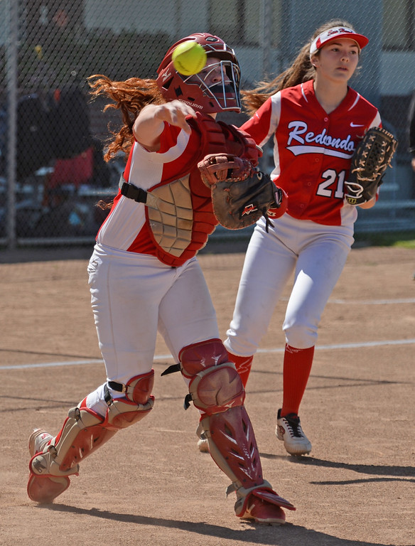 . Redondo\'s Megan Whipp (27) picks up a bunt and gets the out on Peninsula in a Bay League softball game Wednesday, April 19, 2017, Rolling Hills Estates. (Photo by Steve McCrank, Daily Breeze/SCNG)
