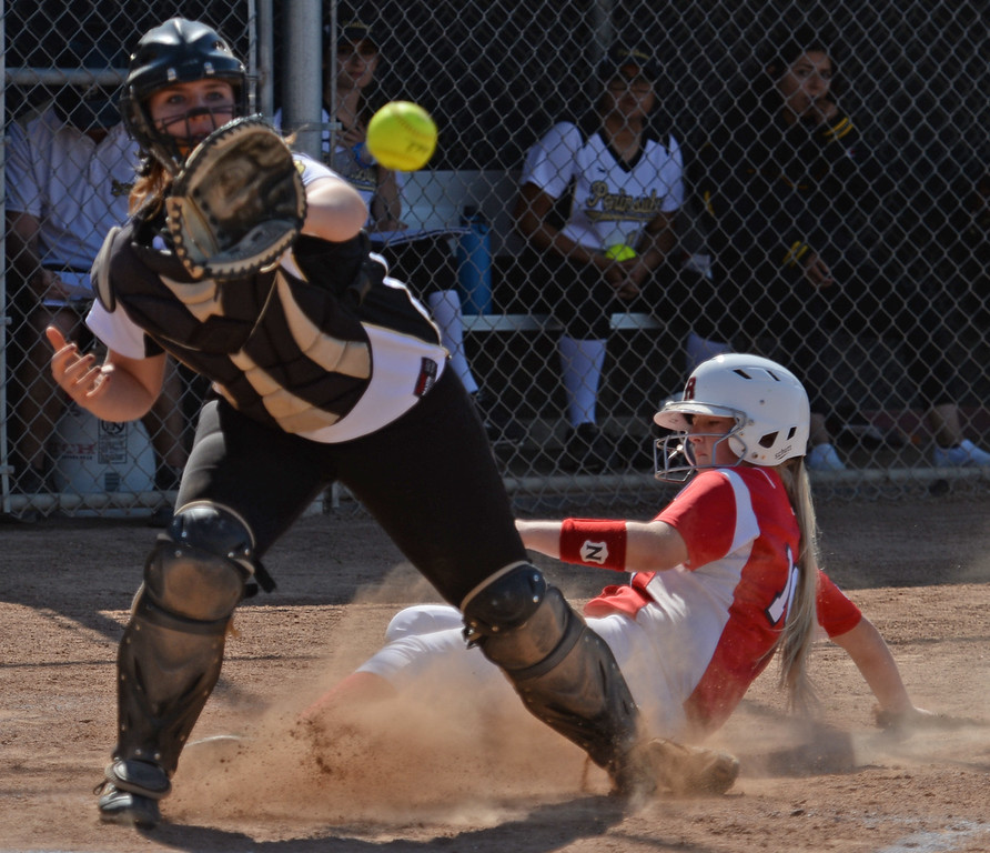 . Redondo\'s Dara English (10) beats the throw to Peninsula\'s catcher Jenna Henry (16) in a Bay League softball game Wednesday, April 19, 2017, Rolling Hills Estates. (Photo by Steve McCrank, Daily Breeze/SCNG)