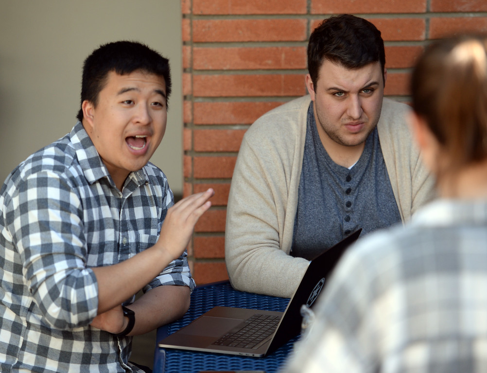 . The El Camino College speech and debate team is looking to win three national titles this year  Monday, March 13, 2017, Torrance, CA. Coach Harrison Shieh, left, and former debate team member Mason Jones, center, work with Victoria Marshall on her speech delivery. Photo by Steve McCrank, Daily News/SCNG