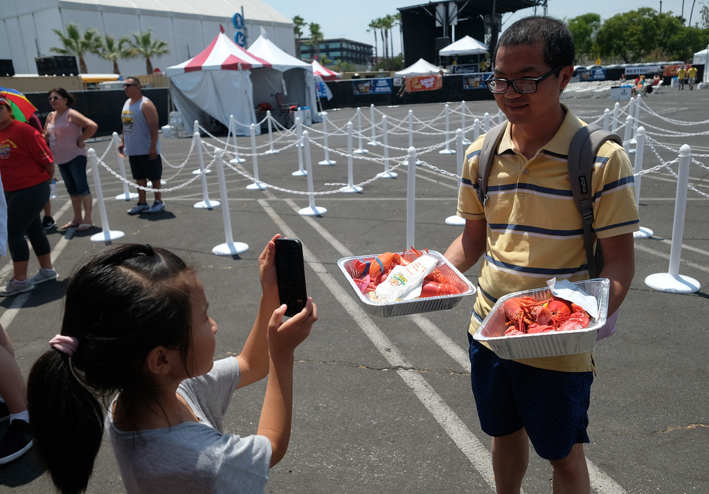 . The 19th Annual Port of Los Angeles Lobster Festival was held by the Battleship Iowa Saturday, July 15, 2017, San Pedro, CA.  Lobsterfest participants were able to purchase a Maine lobster and partake in a fairway, music, and shopping. (Photo by Steve McCrank, Daily Breeze/SCNG)