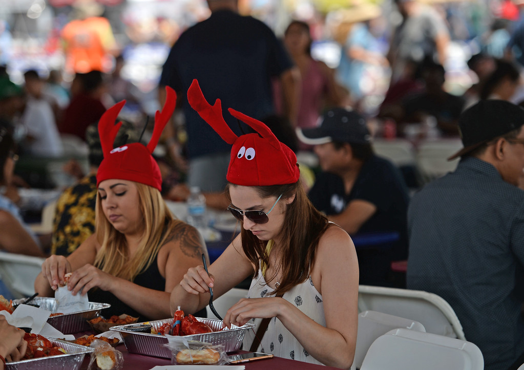 . The 19th Annual Port of Los Angeles Lobster Festival was held by the Battleship Iowa Saturday, July 15, 2017, San Pedro, CA.  Lobsterfest participants were able to purchase a Maine lobster and partake in a fairway, music, and shopping.  People wearing the ubiquitous lobster hat dine under a shaded canopy with thousands of others. (Photo by Steve McCrank, Daily Breeze/SCNG)