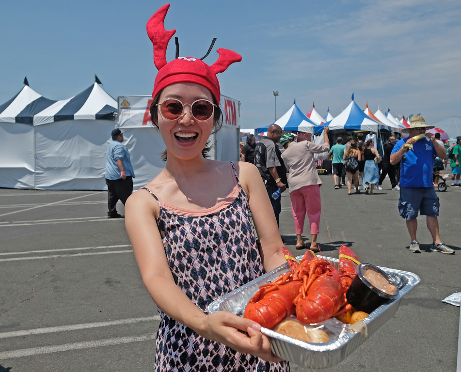 . The 19th Annual Port of Los Angeles Lobster Festival was held by the Battleship Iowa Saturday, July 15, 2017, San Pedro, CA.  Lobsterfest participants were able to purchase a Maine lobster and partake in a fairway, music, and shopping.  People wearing the ubiquitous lobster show their lobster meal. (Photo by Steve McCrank, Daily Breeze/SCNG)