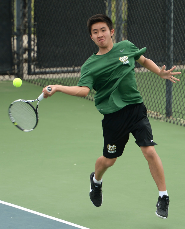 . Mira Costa\'s Matthew Poh makes a powerful return on Palos Verdes\' Eric Chung in the number 2 singles game of a Bay League tennis match Tuesday, April 18, 2017, Palos Verdes Estates. (Photo by Steve McCrank, Daily Breeze/SCNG)
