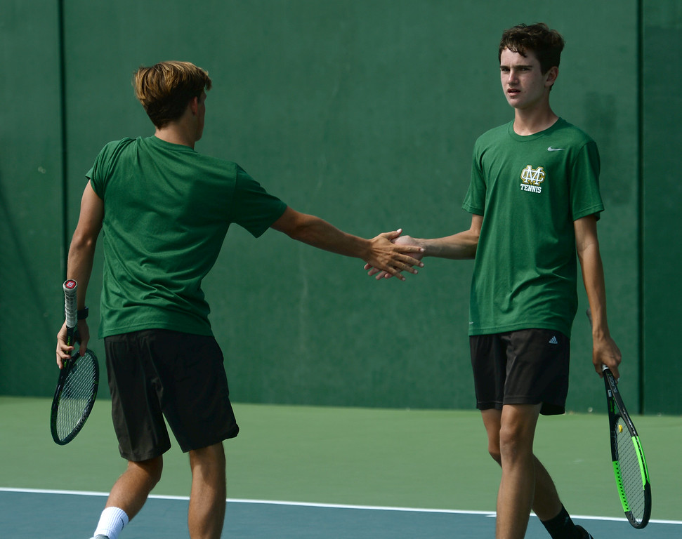 . Mira Costa\'s Alex Fry, left, and Kyle Sillman, right, celebrate a point on Palos Verdes in the number 1 doubles of a Bay League tennis match Tuesday, April 18, 2017, Palos Verdes Estates. (Photo by Steve McCrank, Daily Breeze/SCNG)