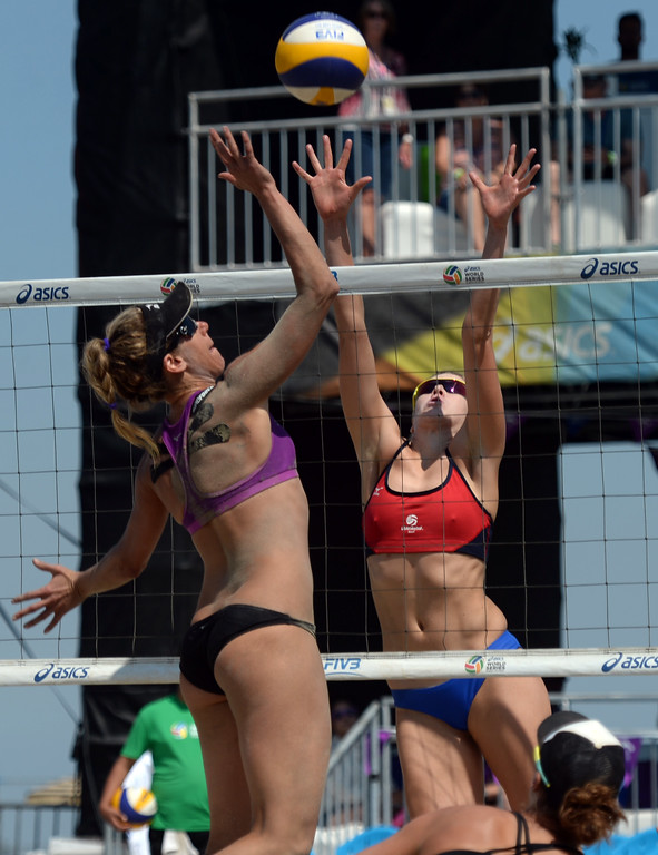 . April Ross tries to place a kill through Summer Ross in quarterfinals of the World Series of Beach Volleyball Friday, July 14, 2017, Long Beach, CA.  April Ross and Lauren Fendrick defeated Summer Ross and Brooke Sweat in two sets. (Photo by Steve McCrank, Daily Breeze/SCNG)