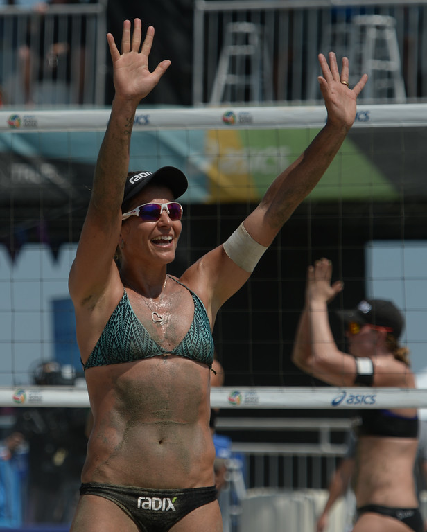 . Brazilian Larissa Franca celebrates with Brazil fans  after she and teammate Talita beat Germans Chantal Labourer and Julia Sude in quarterfinals of World Series of Beach Volleyball Friday, July 14, 2017, Long Beach, CA.   (Photo by Steve McCrank, Daily Breeze/SCNG)