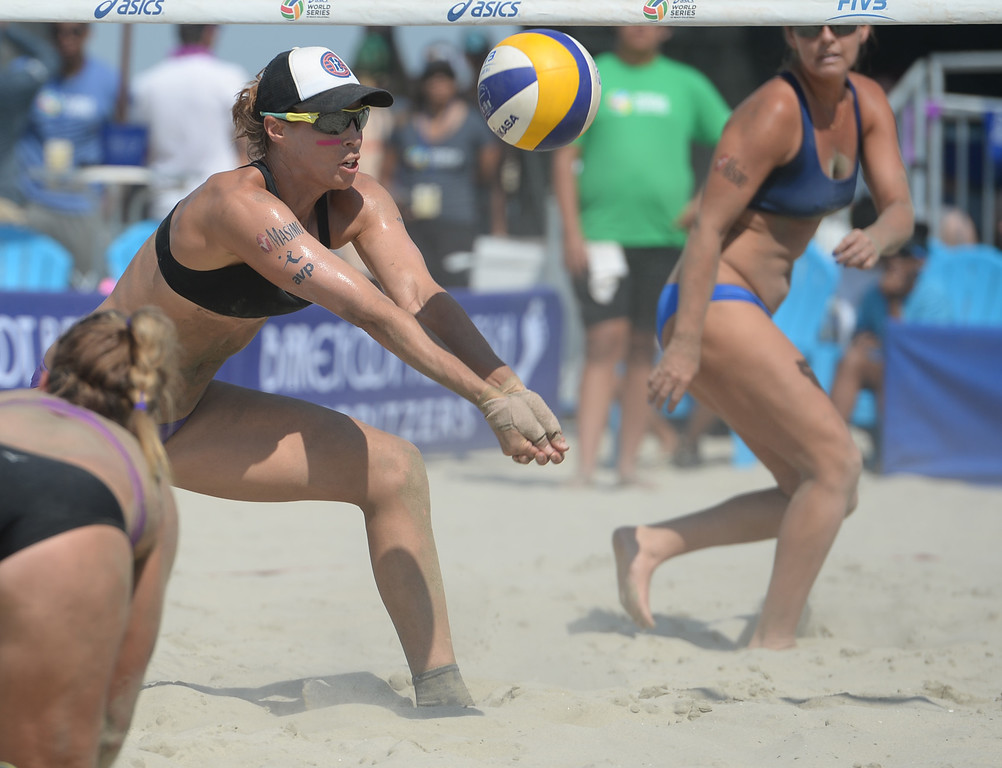 . Lauren Fendrick makes the set as April Ross gets back to her feet in quarterfinals of the World Series of Beach Volleyball Friday, July 14, 2017, Long Beach, CA.  April Ross and Lauren Fendrick defeated Summer Ross and Brooke Sweat in two sets. (Photo by Steve McCrank, Daily Breeze/SCNG)