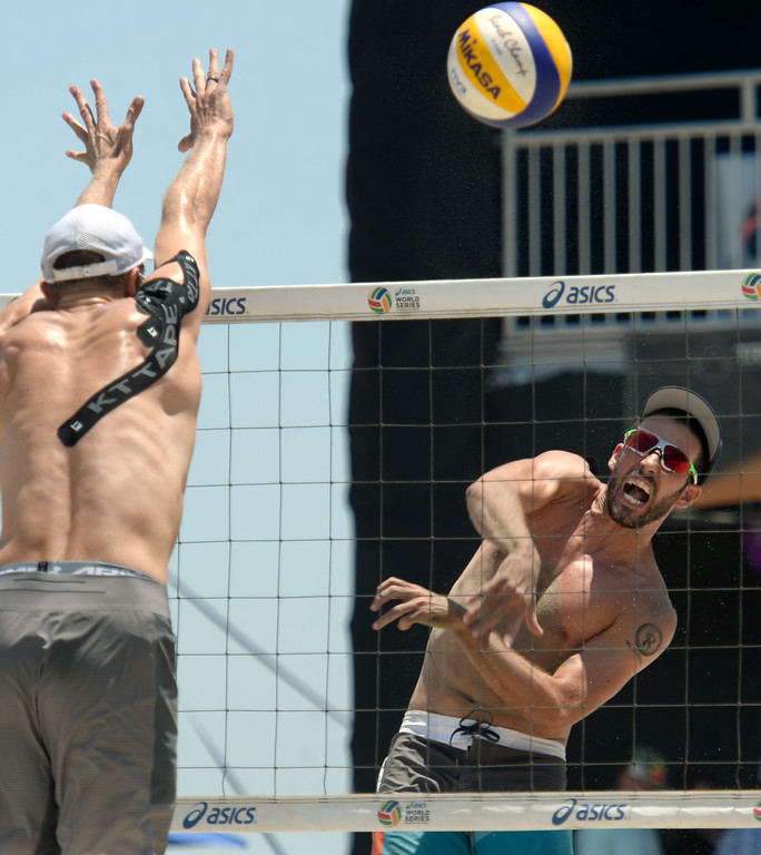 . Nick Lucena spikes past Theo Brunner in pool play of the World Series of Beach Volleyball Friday, July 14, 2017, Long Beach, CA.  Nick Lucena and Phil Dalhausser defeated Theo Brunner and Casey Patterson in two sets. (Photo by Steve McCrank, Daily Breeze/SCNG)