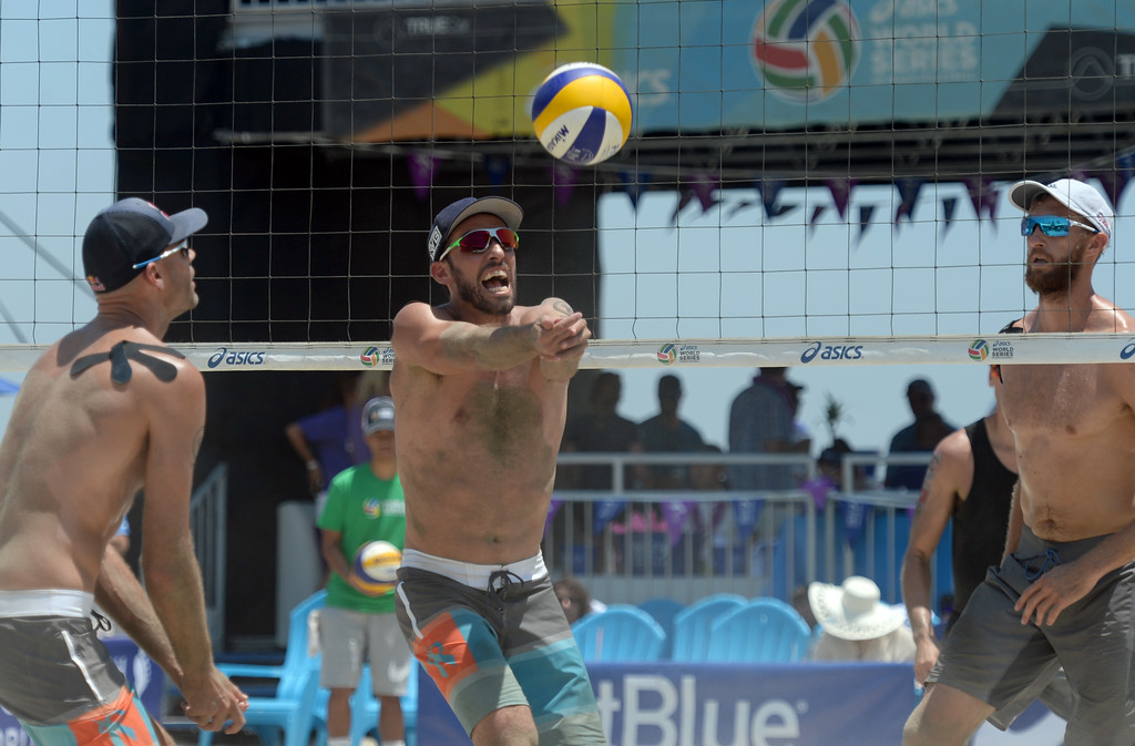 . Nick Lucena brings the ball under control in pool play of the World Series of Beach Volleyball Friday, July 14, 2017, Long Beach, CA.  Nick Lucena and Phil Dalhausser defeated Theo Brunner and Casey Patterson in two sets. (Photo by Steve McCrank, Daily Breeze/SCNG)