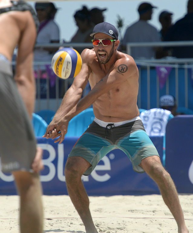 . Nick Lucena digs a serve in pool play of the World Series of Beach Volleyball Friday, July 14, 2017, Long Beach, CA.  Nick Lucena and Phil Dalhausser defeated Theo Brunner and Casey Patterson in two sets. (Photo by Steve McCrank, Daily Breeze/SCNG)