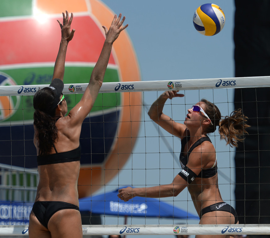 . German Chantal Labourer swats the ball in reverse faking Brazilian Talita Antunes in quarterfinals World Series of Beach Volleyball Friday, July 14, 2017, Long Beach, CA.   (Photo by Steve McCrank, Daily Breeze/SCNG)