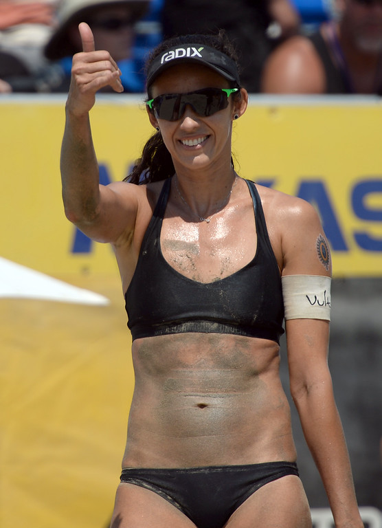 . Brazilian Talita Antunes celebrates with Brazil fans after she and teammate Larissa beat Germans Chantal Labourer and Julia Sude in quarterfinals of World Series of Beach Volleyball Friday, July 14, 2017, Long Beach, CA.   (Photo by Steve McCrank, Daily Breeze/SCNG)
