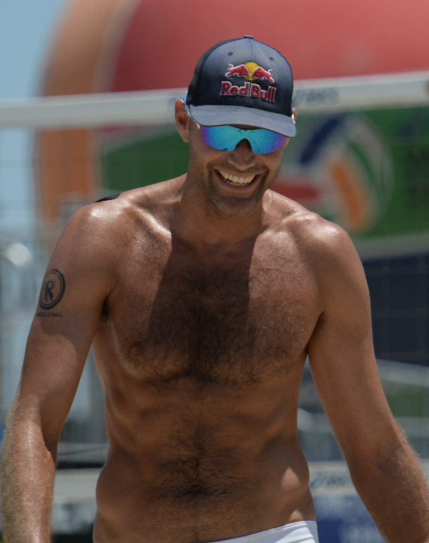 . Phil Dalhausser flashes the rare smile as he and Nick Lucena go up on Theo Brunner in pool play of the World Series of Beach Volleyball Friday, July 14, 2017, Long Beach, CA.  Nick Lucena and Phil Dalhausser defeated Theo Brunner and Casey Patterson in two sets. (Photo by Steve McCrank, Daily Breeze/SCNG)